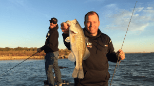 Ryan Newman fishes with fellow driver Martin Truex Jr.