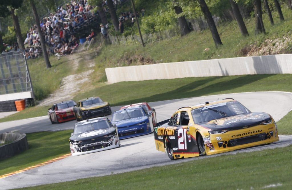 Daniel Hemric earned his third stage win of the 2018 season at Road America and locked up a spot in the Xfinity Series playoffs.