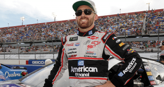 Austin Dillon shows off his Dale Earnhardt-inspired throwback American Ethanol firesuit before the Bojangles' Southern 500 at Darlington Raceway.