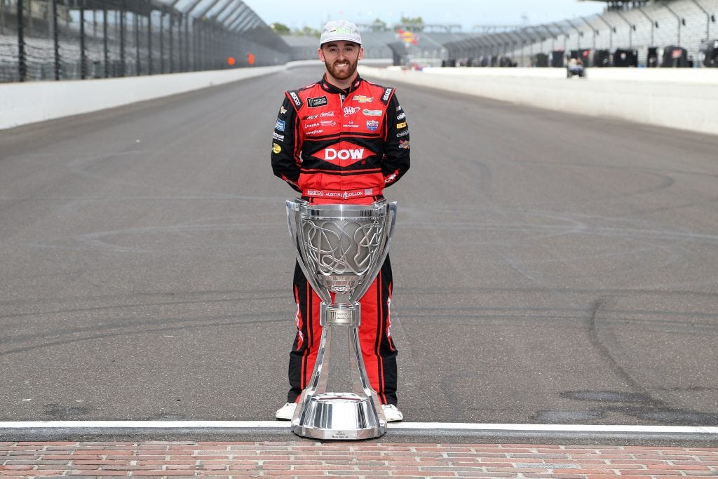 Austin Dillon poses with the Monster Energy NASCAR Cup Series trophy after advancing to the Playoffs for the second consecutive season. Photo: Brian Lawdermilk | Getty Images