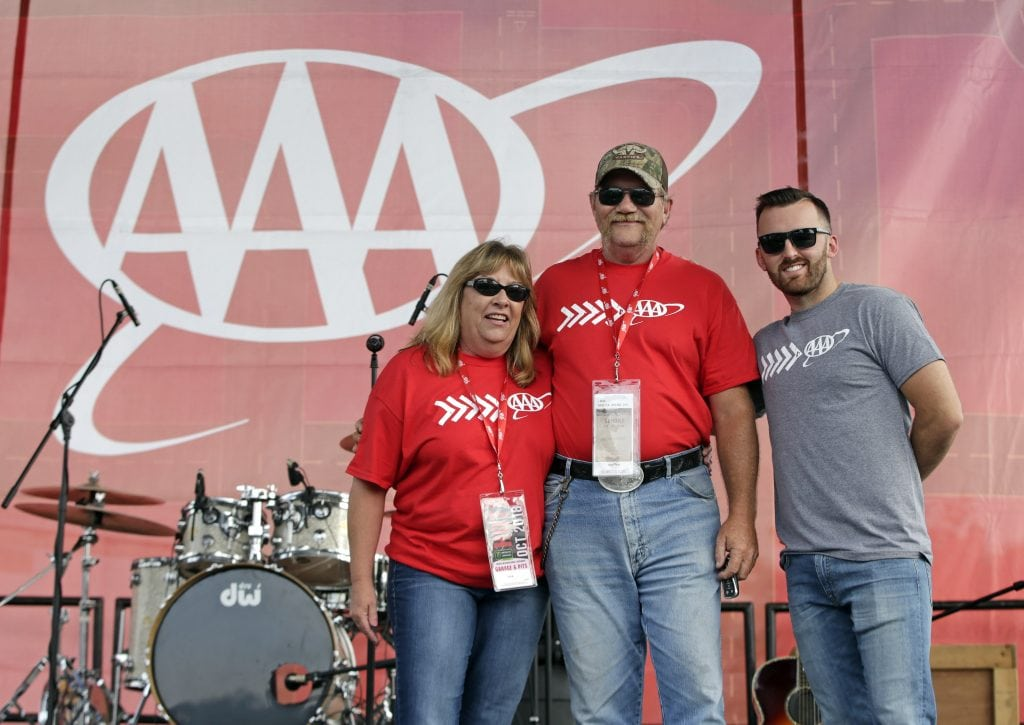 Robert Walker and his wife appear on stage after being presented with a 2018 Chevrolet Camaro ZL1 by Austin Dillon and AAA. (HHP/Alan Marler)
