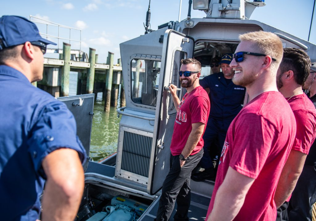 Coca-Cola Racing family driver Austin Dillon and crew members go through learn about Coast Guard Station Wrightsville Beach Island on Tuesday.
