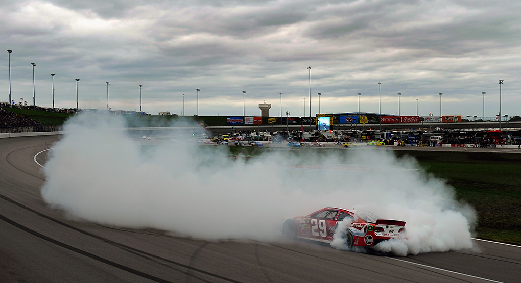 Kevin Harvick smokes the tires on the No. 29 RCR Chevrolet after winning at Kansas Speedway in October 2013. (Jared C. Tilton/Getty Images)