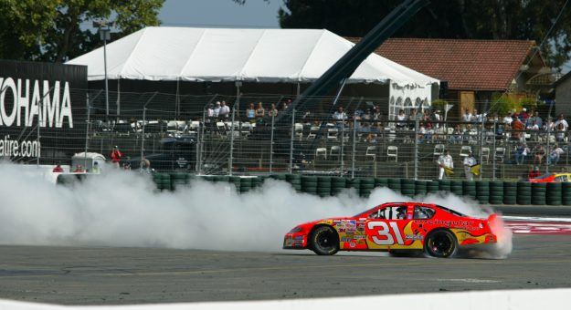 SONOMA, CA - JUNE 22:  Robby Gordon, driver of the #31 Cingular Wireless Chevrolet Monte Carlo, spins doughnuts in his car after winning the NASCAR Winston Cup Dodge Save Mart 350 at the Infineon Raceway on June 22, 2003 in Sonoma, California.  (Photo by Donald Miralle/Getty Images) | Getty Images