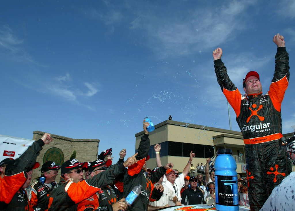 SONOMA, CA - JUNE 22: Robby Gordon, driver of the #31 CIngular Wireless Chevrolet Monte Carlo, celebrates winning the NASCAR Winston Cup Dodge Save Mart 350 at the Infineon Raceway on June 22, 2003 in Sonoma, California. (Photo by Donald Miralle/Getty Images) | Getty Images