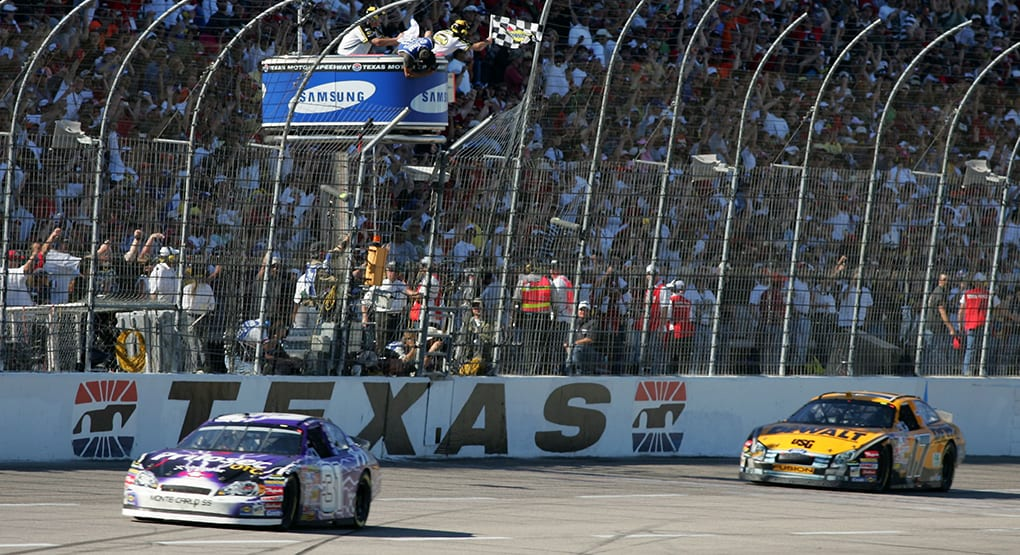Jeff Burton takes the checkered flag in the April 2007 race at Texas Motor Speedway after leading just the final lap. (Todd Warshaw/Getty Images)
