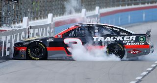 FORT WORTH, TEXAS - JULY 19: Austin Dillon, driver of the #3 Bass Pro Shops Chevrolet, celebrates with a burnout after winning the NASCAR Cup Series O'Reilly Auto Parts 500 at Texas Motor Speedway on July 19, 2020 in Fort Worth, Texas. (Photo by Brian Lawdermilk/Getty Images) | Getty Images